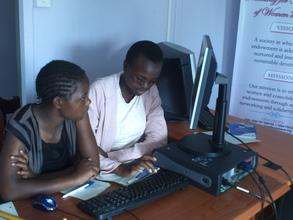 Girls learning computer skills