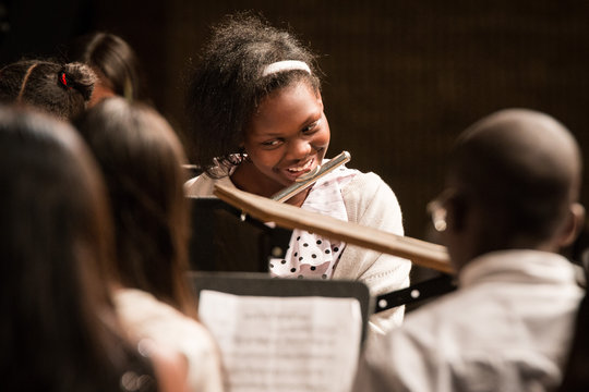 A student plays her flute enthusiastically!