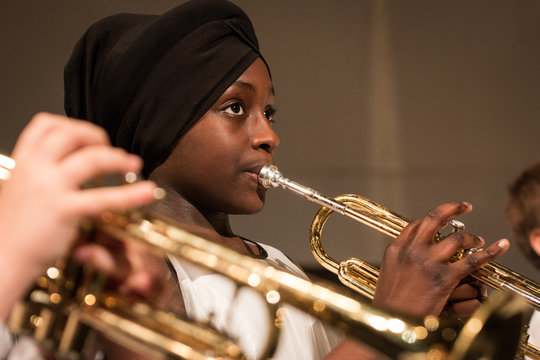 A student concentrates on music-making.