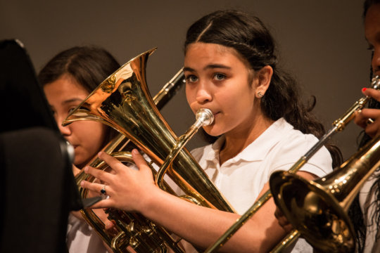 A tuba player concentrates on her music making!