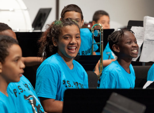 A band student smiles after a performance!