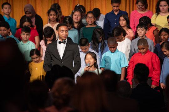 Brandon performs with an ETM partner school choir