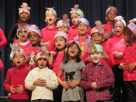 Students sing joyfully at a holiday concert!