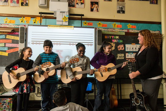 Students enjoy a guitar lesson!
