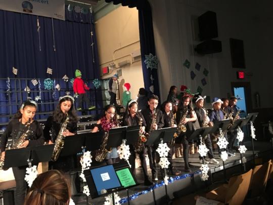 Festive band students play passionately!