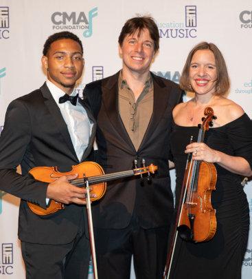Brandon (L) & his music teacher (R) w/ Joshua Bell