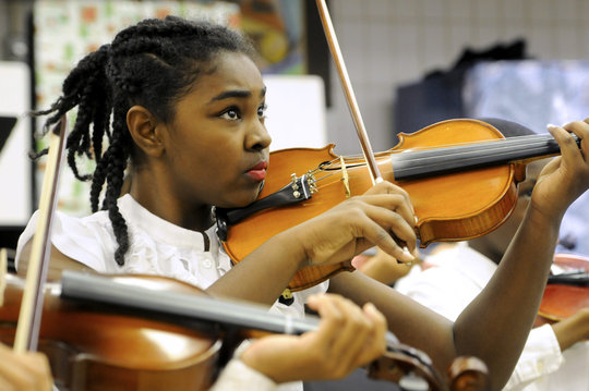 A student focuses before performing her next piece