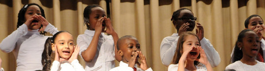 Students engage in gleeful singing