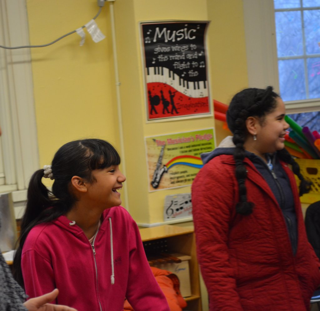 Students smile infectiously during music class!