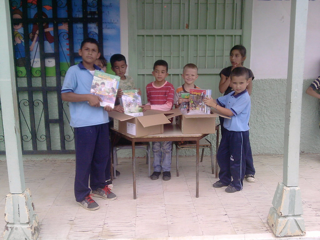 Students opening boxes with new school materials
