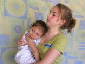 A volunteer holding Alejandra