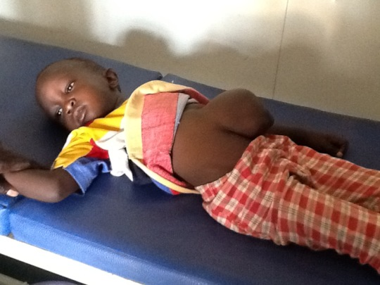 Emmanuel waits to be examined at the hospital