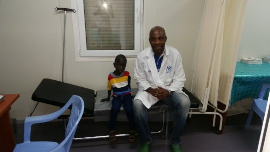 Emmanuel with Dr. Joseph one year after surgery