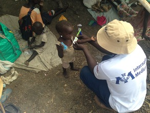 Checking a child for malnutrition