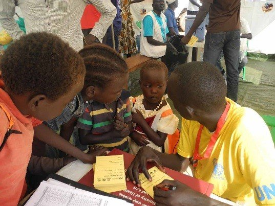 Children sign up to receive cholera vaccination
