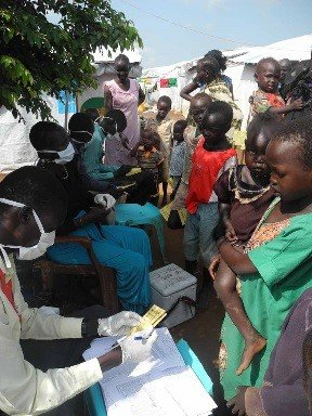Families line up to receive vaccination cards