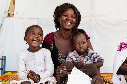 A mother with children - by Maya Baldauf