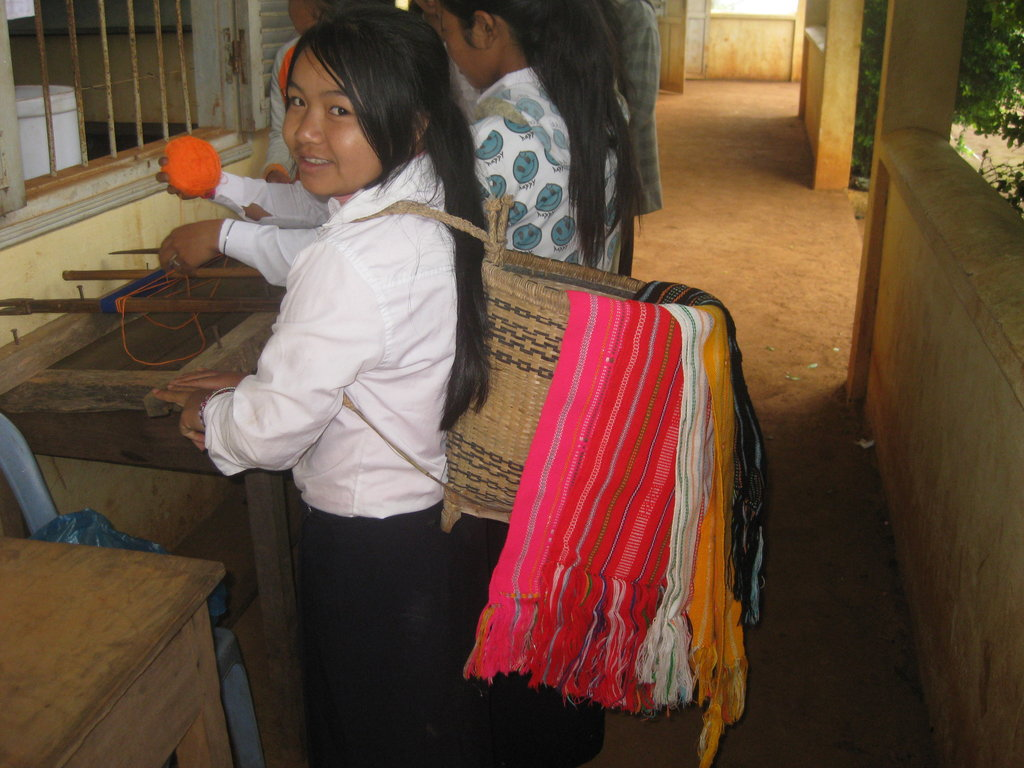 A PEI student with traditional Phnong handicrafts