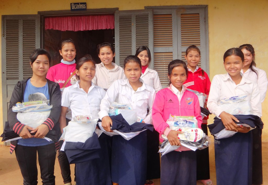 Secondary students with study materials/uniforms