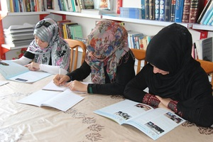 Girls working in an AIL Library!