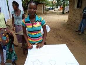 Aminata works on her wax design