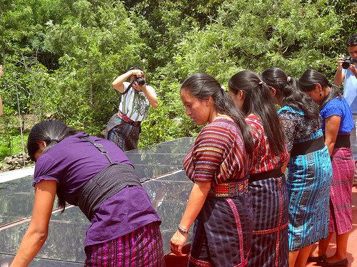 Mayan girls examining solar panels