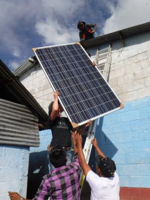 Solar installed by volunteers powers computers