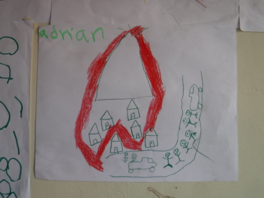 A child's drawing on the wall of their shelter
