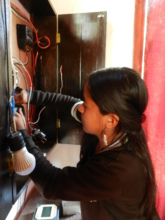 Fatima working on a 80W Solar System at CCDA