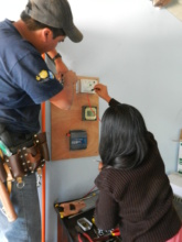 Fatima and Jose, engineer, hooking up 245W system
