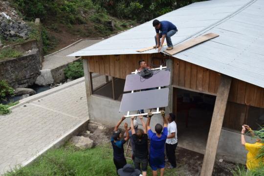 Solar panels go up on Community Meeting Hall