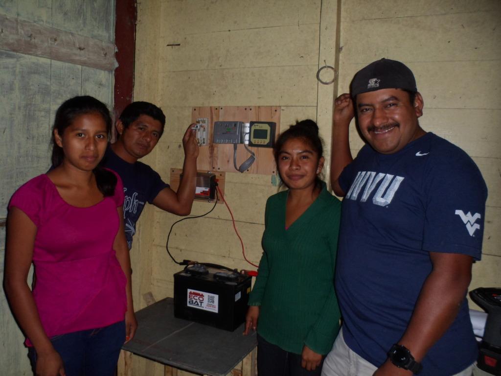Community members hook up solar components