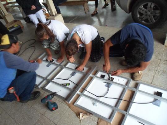 Volunteers and community members work together