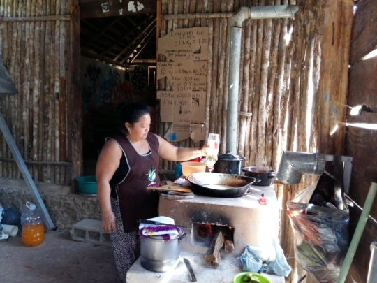 Dona Ana using her clean cookstove in Quintana Roo