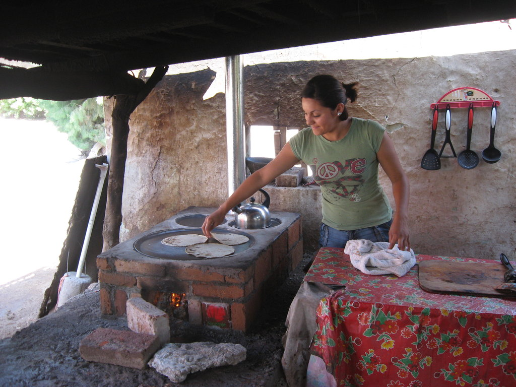 Heating tortillas on a Patsari stove