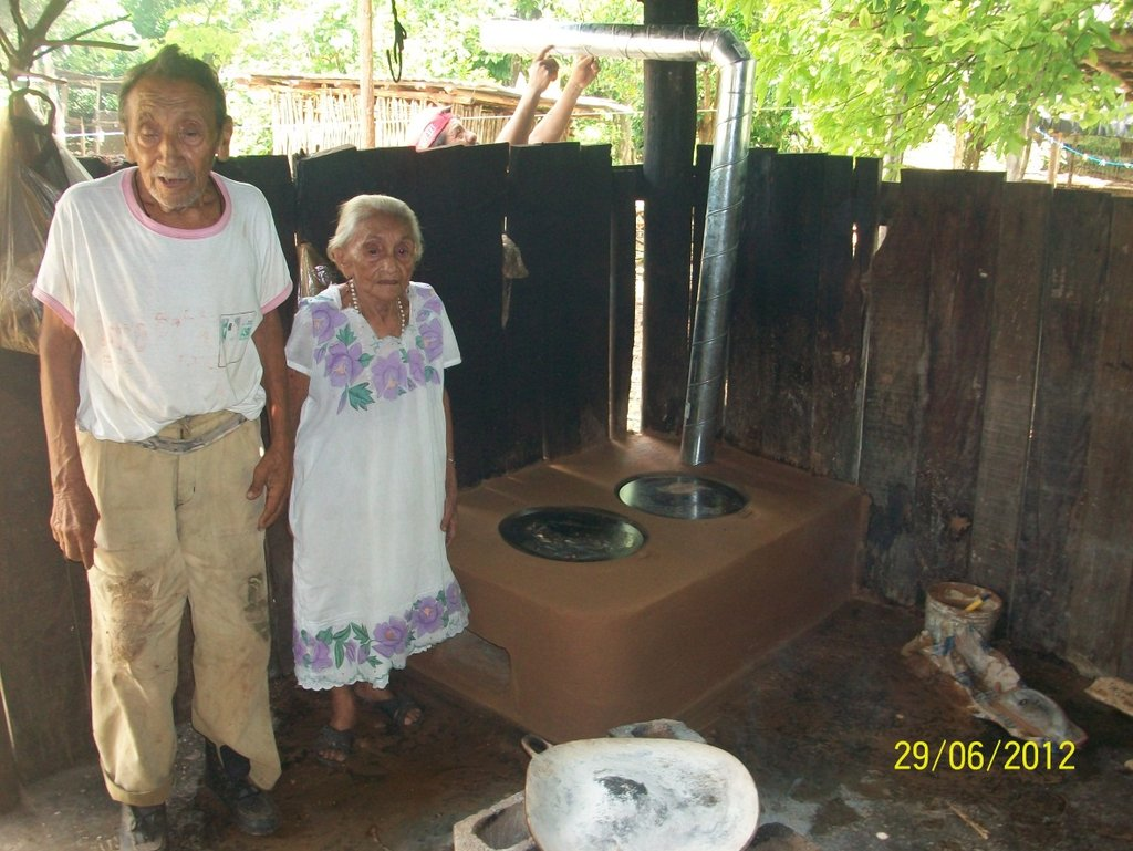 Apolinaria and her husband with new cookstove