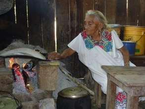 Apolinaria's traditional bonfire pre-cookstove