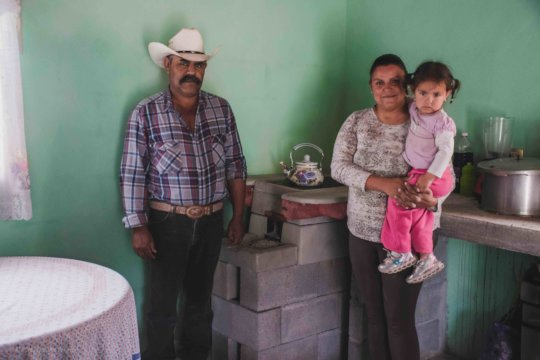 Family in Coahuila with wood-saving stove