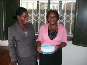 Esther and Sylvia, FCDE program staff celebrating