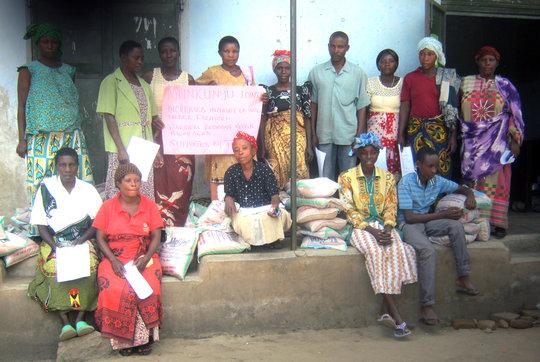 Munkunyu Group Picking up Initial Bean Seeds