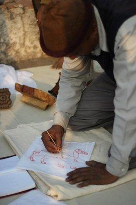 Artist Salim tries to draw his design