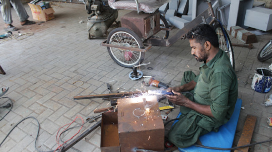 Imran Ghanchi works on the Accessible Tricycle