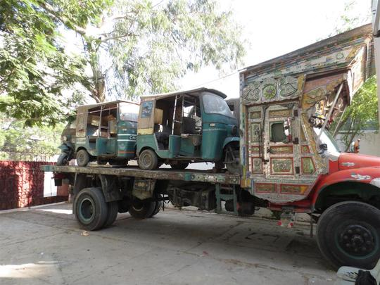 Our  rickshaws being moved to the new office