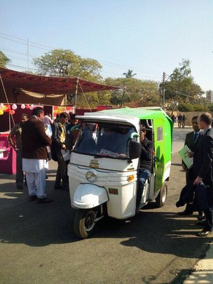 Our rickshaw navigating through a conference