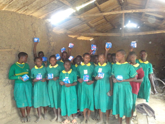 Young girls with the pads they received