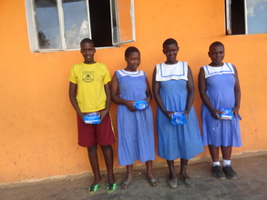 Daphine with her fellow children at school