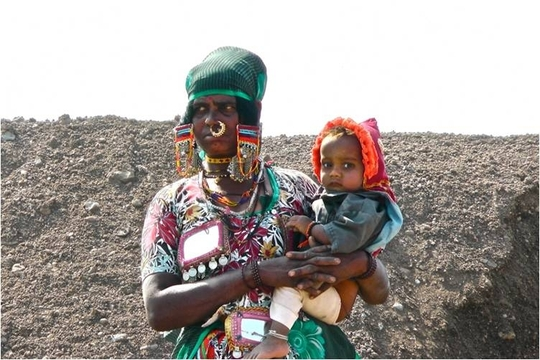 Women working at Bandhara with her babay