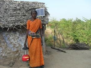 P. Lakhmi with solar lantern provided