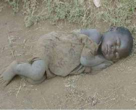 Street child sleeps on the road