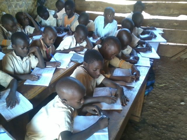 Children using books and pens from Global giving